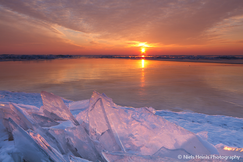 Warm colours over a frozen IJsselmeer