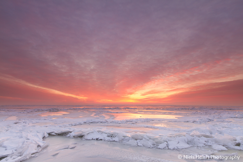 Warm sunset colours on frozen lake - IJsselmeer, The Netherlands